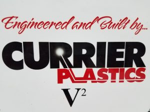"Sign that reads "" engineered and built by Currier Plastics"""